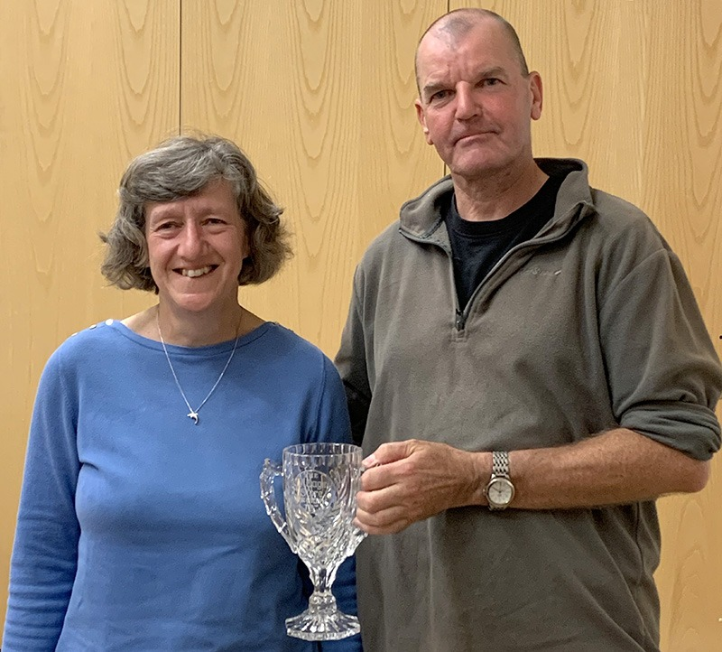"""Anna Mayall receives the """"Most Improved"""" award from Brian Goldie"""